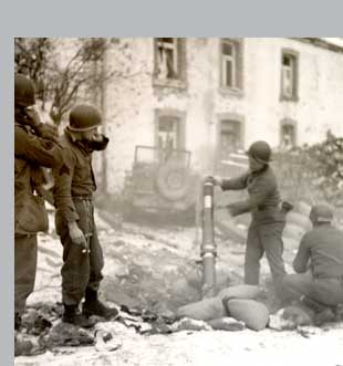 Soldiers of a chemical battalion attached to the 35th Infantry Division fire a 4.2 inch mortar in Belgian town near Bastogne.